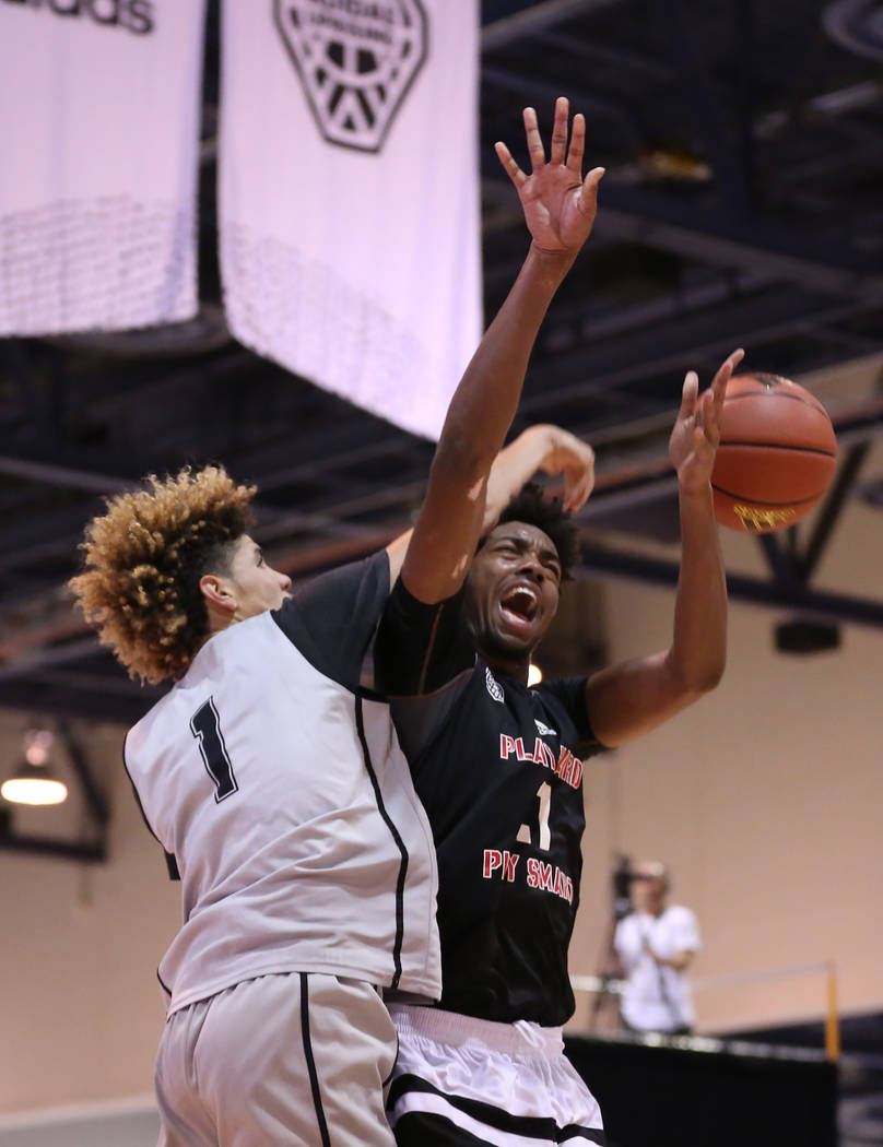 Big Baller Brand player LaMelo Ball, left, knocks the ball away from Play Hard Play Smart player Jordan Brown during an Adidas Summer Championship AAU tournament game at Cashman Center in Las Vega ...