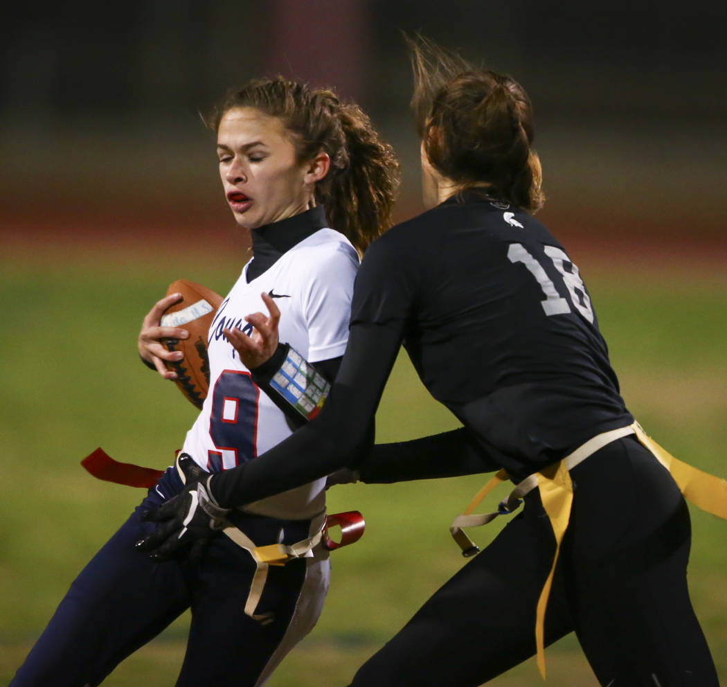 Cimarron-Memorial's Haylie Hughes (18) tags out Coronado's Caitlin Shannon (9) during the Class 4A state championship flag football game at Cimarron-Memorial High School in Henderson on Wednesday, ...