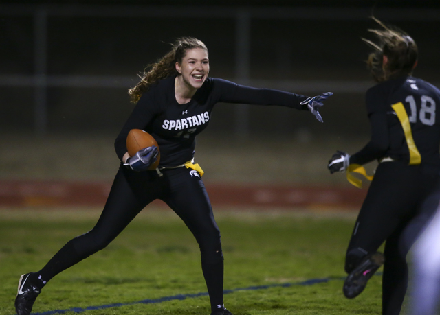 Cimarron-Memorial's Alyssa Karpinski (17) celebrates with Cimarron-Memorial's Haylie Hughes (18) after scoring a touchdown against Coronado during the Class 4A state championship flag football gam ...
