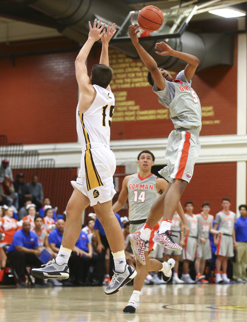 Clark's James Bridges (15) and Bishop Gorman's Chuck O'Bannon (5) go up for a long pass during a basketball game at Clark High School in Las Vegas on Tuesday, Jan. 3, 2017. Bishop Gorman won 70-63 ...