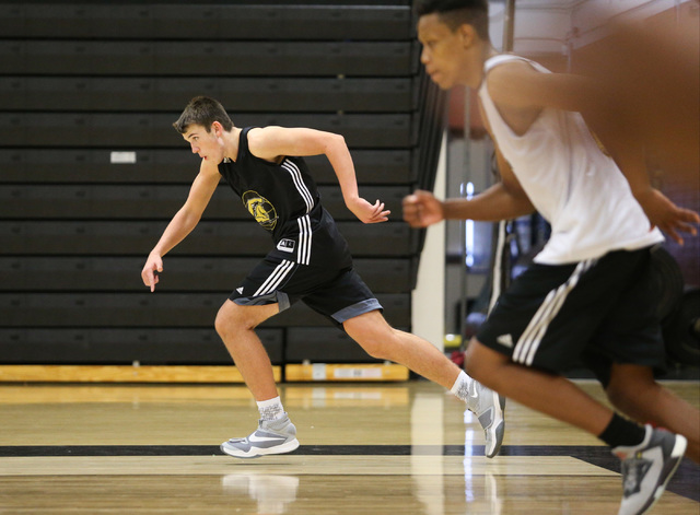 Clark guard James Bridges, center, runs a drill during practice at Ed W. Clark High School in Las Vegas on Tuesday, Nov. 22, 2016. Brett Le Blanc/Las Vegas Review-Journal Follow @bleblancphoto