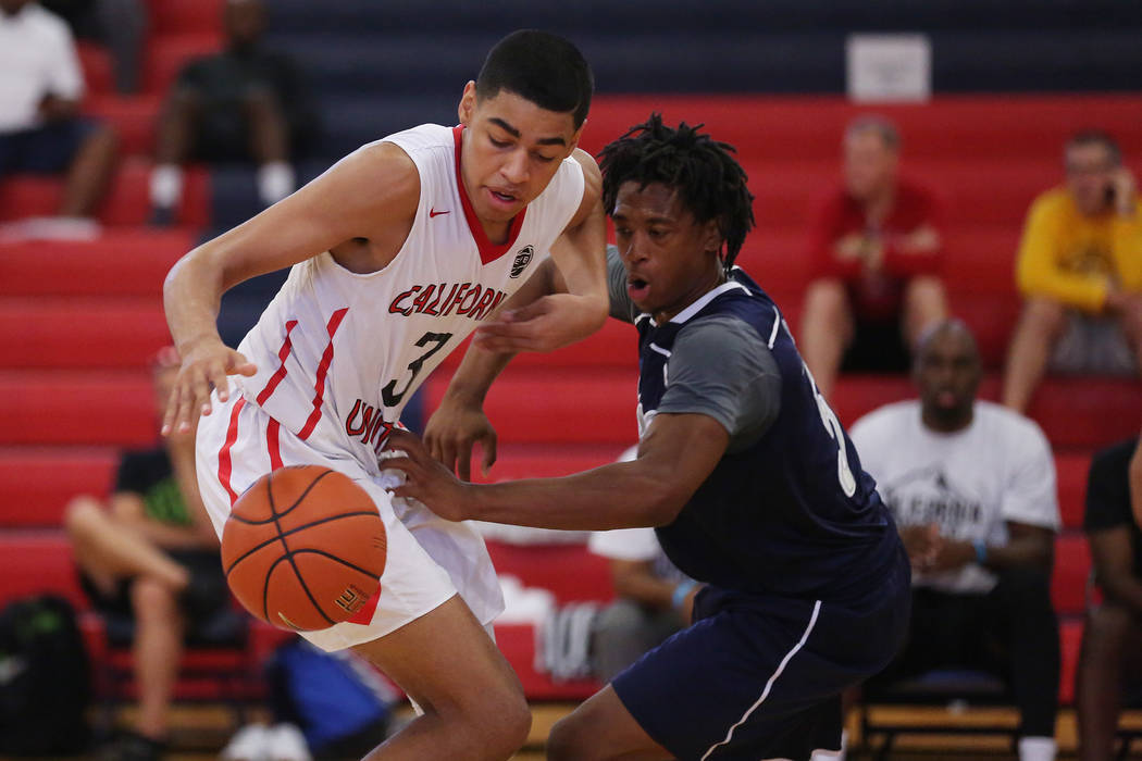 Liberty sophomore and California United player Julian Strawther (3) and Rise player Sincere Jones (5) fight for the ball during an AAU game at Liberty High School on Friday, July 28, 2017 in Hende ...