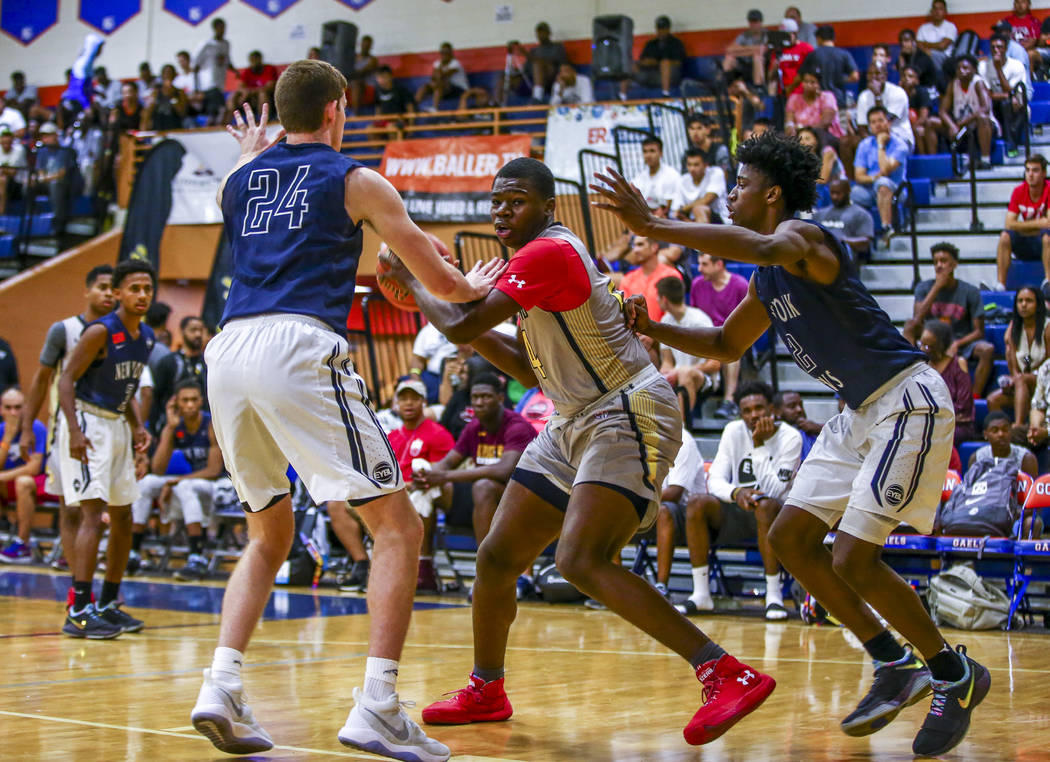 Team Thad's Javian Fleming, center, defends the ball against New York defenders Sloan Seymour, left, and Khalid Moore during the Las Vegas Fab 48 Championship Game on Sunday, July 30, 2017. Team T ...
