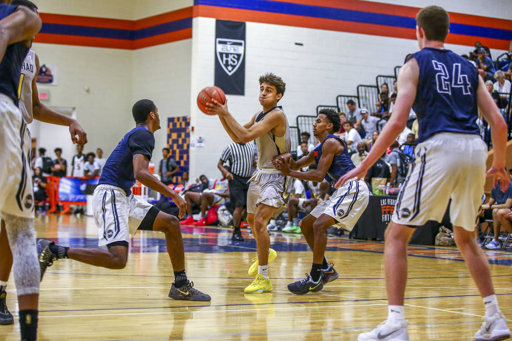 Team Thad's Roman Ruio, center, looks to pass while warding off New York defenders during the Las Vegas Fab 48 Championship Game on Sunday, July 30, 2017. Team Thad won 77-61 over New York.  Patri ...