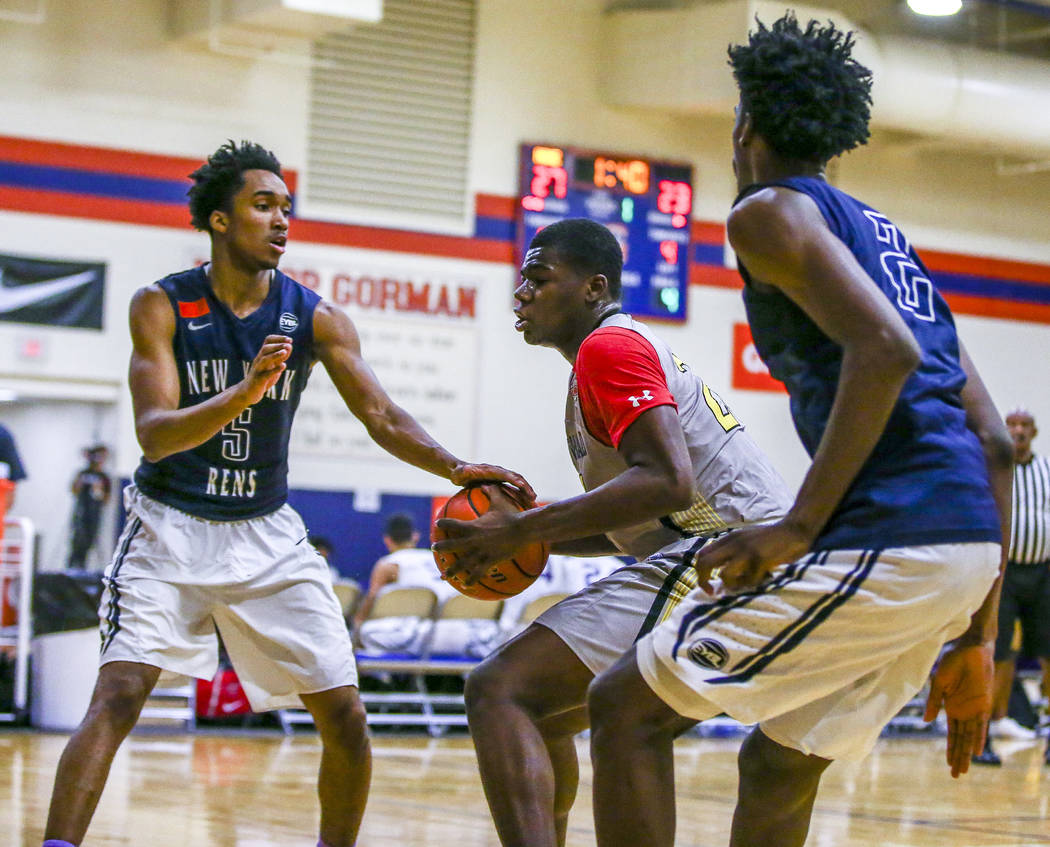 Team Thad's Javian Fleming , center, defends the ball against New York defenders Bryce Wills, left, and Khalid Moore during the Las Vegas Fab 48 Championship Game on Sunday, July 30, 2017. Team Th ...