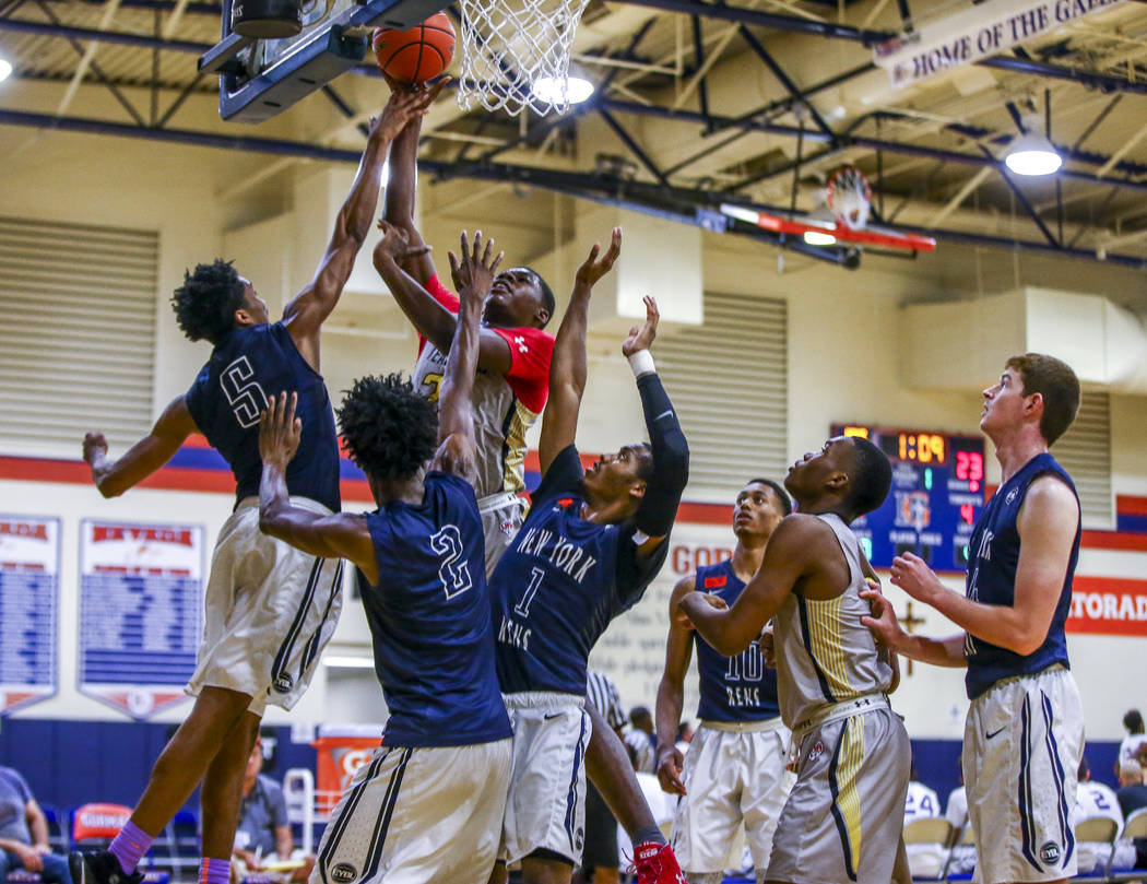 Team Thad's Javian Fleming goes up for a shot against a myriad of New York defenders during the Las Vegas Fab 48 Championship Game on Sunday, July 30, 2017. Team Thad won 77-61 over New York.  Pat ...