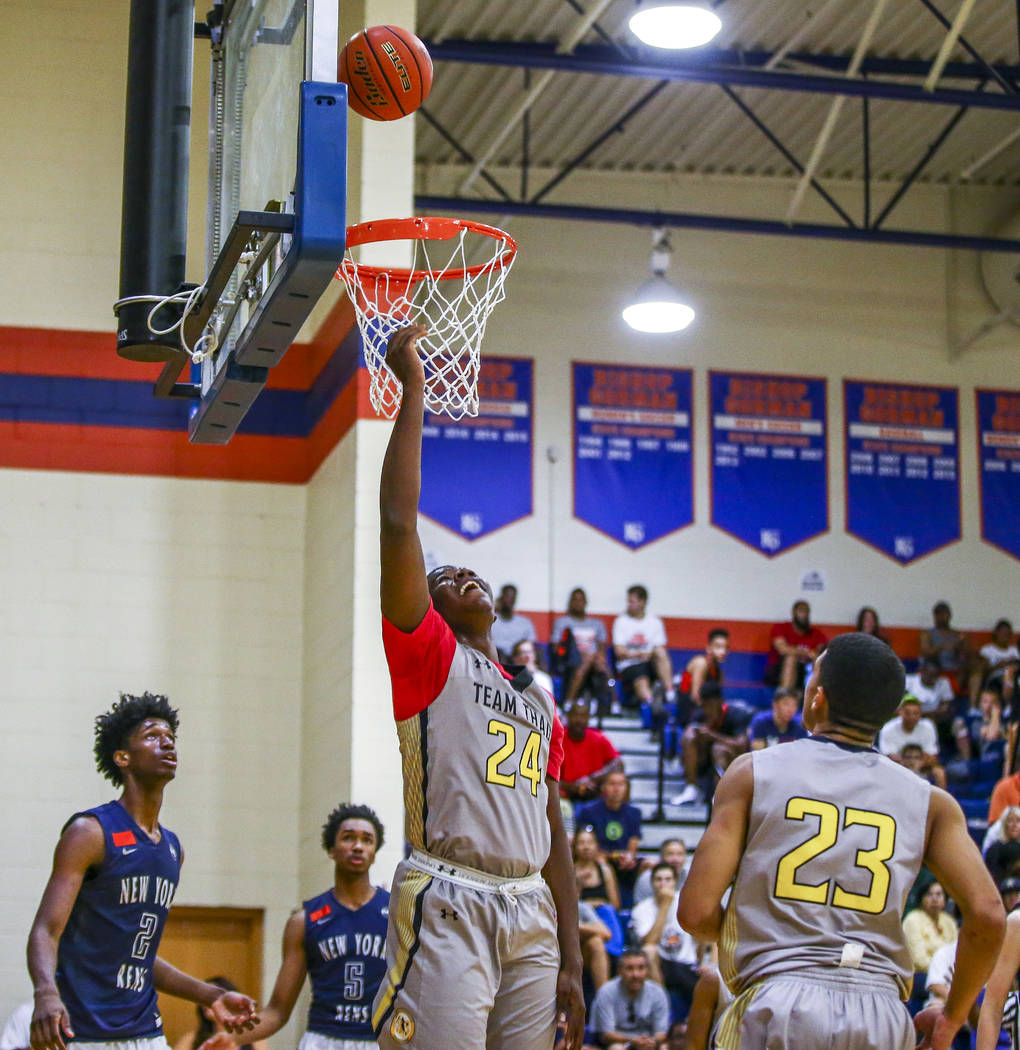 Team Thad's Javian Fleming (24) attempts a layup during the Las Vegas Fab 48 Championship Game on Sunday, July 30, 2017, as his teammate Trenton Gibson (23) and New York defenders Khalid Moore (2) ...
