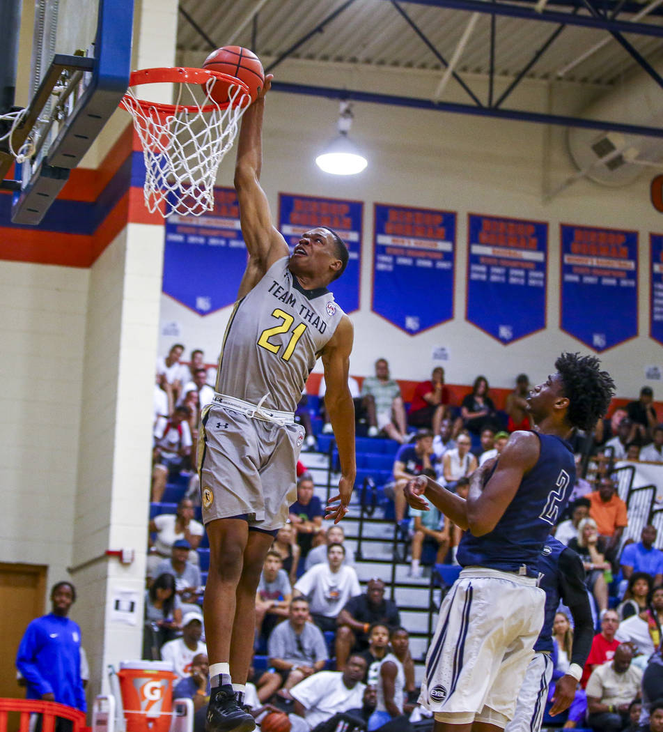 Team Thad's Robert Woodard II (21) makes a dunk against New York's Khalid Moore (2) during the Las Vegas Fab 48 Championship Game on Sunday, July 30, 2017. Team Thad won 77-61 over New York.  Patr ...