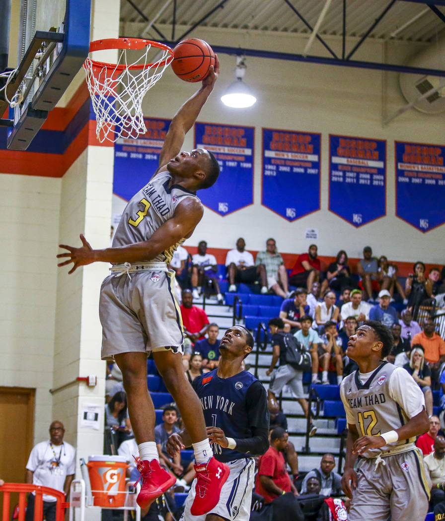 Team Thad's Tavin Lovan makes a dunk against New York during the Las Vegas Fab 48 Championship Game on Sunday, July 30, 2017, as his teammate Christian Jones (12) and New York's Luther Muhammad (1 ...