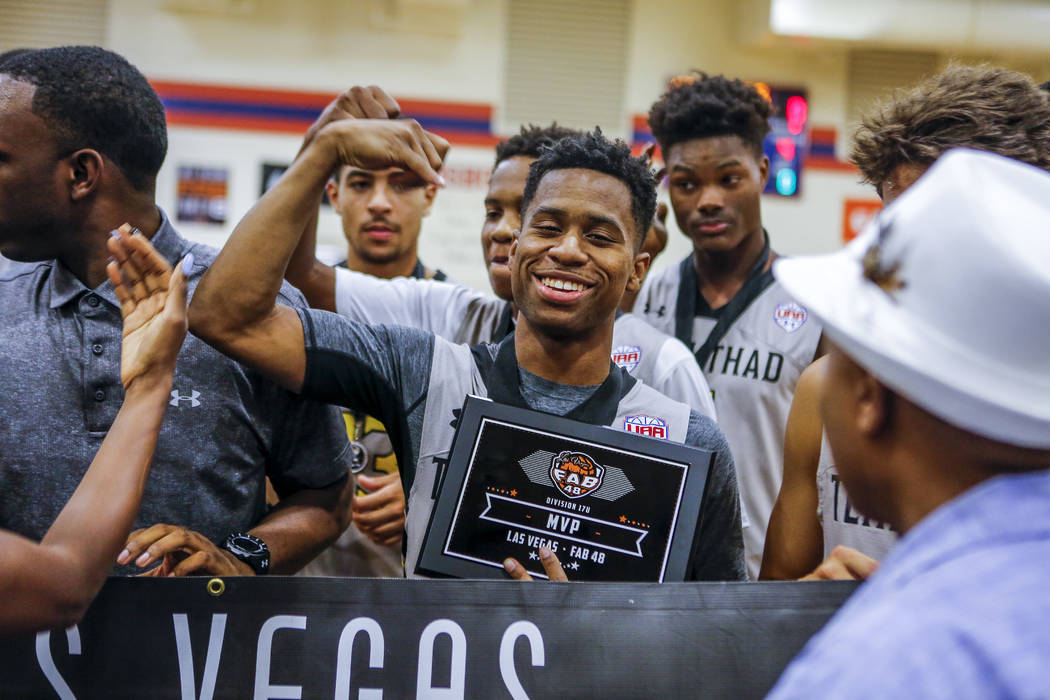 Team Thad's Tyler Harris, center, celebrates after being crowned MVP during the Las Vegas Fab 48 Championship Game on Sunday, July 30, 2017. Team Thad won 77-61 over New York.  Patrick Connolly La ...