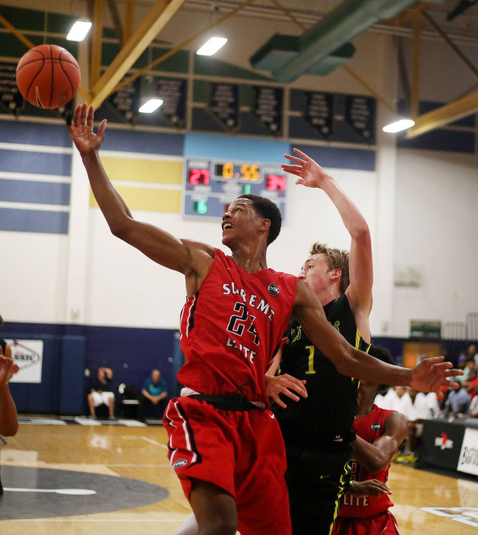 California Supreme's Shareef O'Neal, 24, left, and Las Vegas Prospects' Moses Wood,1, fight for the ball during the Platinum Elite Championship game of the Las Vegas Classic AAU tournament at Spri ...