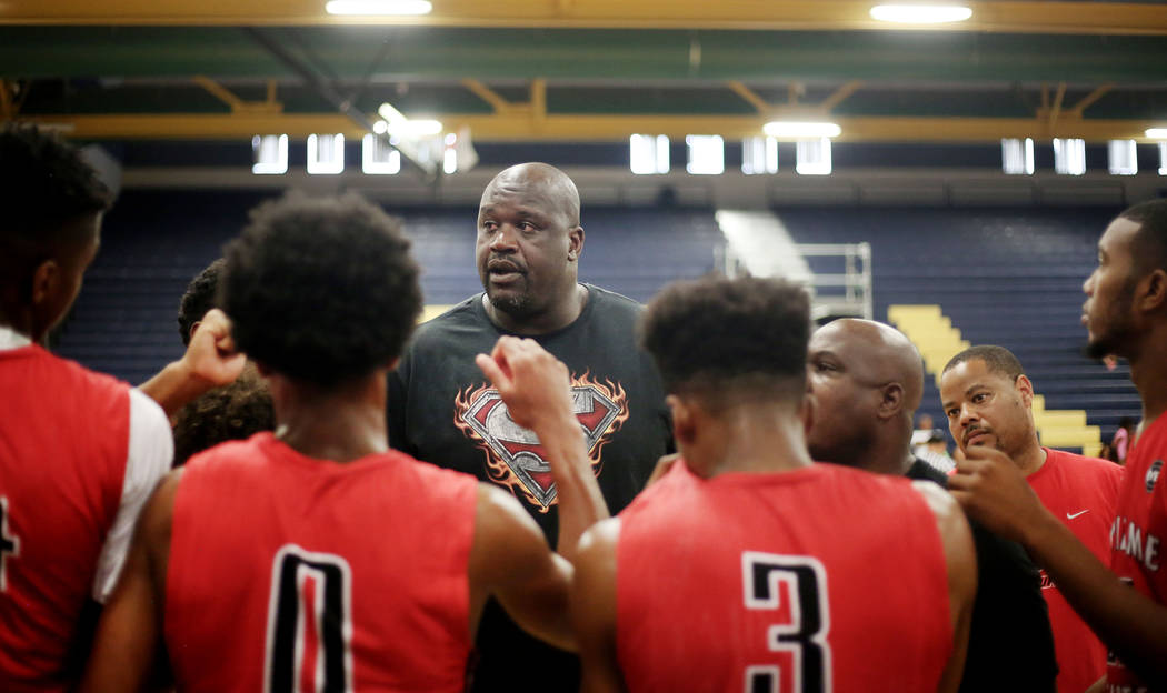 California Supreme Elite assistant coach Shaquille O'Neal speaks with his team on a time out during the Las Vegas Prospects for the Platinum Elite Championship game of the Las Vegas Classic AAU to ...