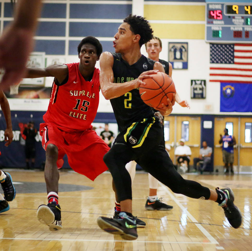 Las Vegas Prospects' Marvin Coleman II, 2,  handles the ball against California Supreme's Fred Odhiambo, 15, during the Platinum Elite Championship game of the Las Vegas Classic AAU tournament at  ...