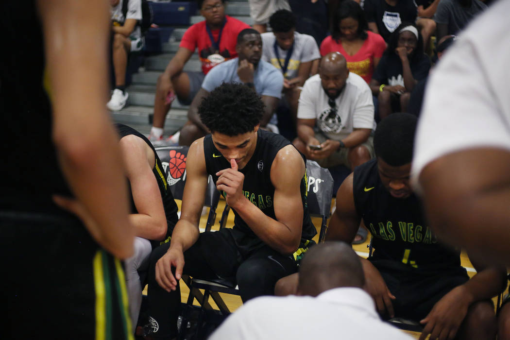 Las Vegas Prospects' Marvin Coleman II, center, listens in a huddle during the Platinum Elite Championship game of the Las Vegas Classic AAU tournament against California Supreme at Spring Valley  ...
