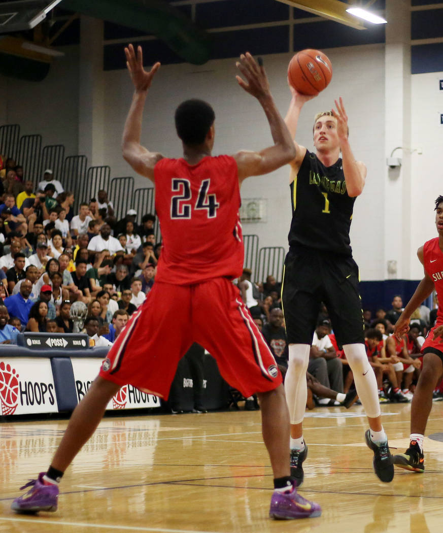 California Supreme's Shareef O'Neal, 24, gaurds Las Vegas Prospects' Moses Wood,1, during the Platinum Elite Championship game of the Las Vegas Classic AAU tournament at Spring Valley High School  ...