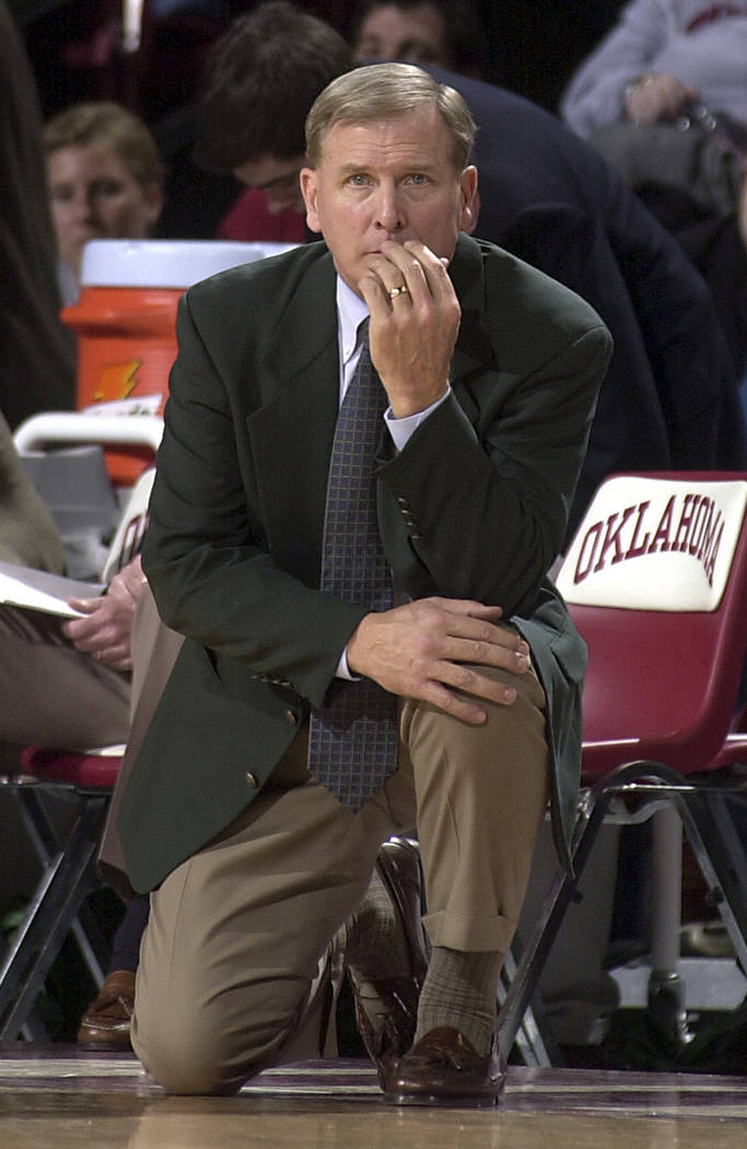 In this Feb. 8, 2003, file photo, former Baylor head coach Dave Bliss watches as his Baylor team gets routed by Oklahoma during a Big 12 Conference game in Norman, Okla. (AP Photo/Jerry Laizure, File)