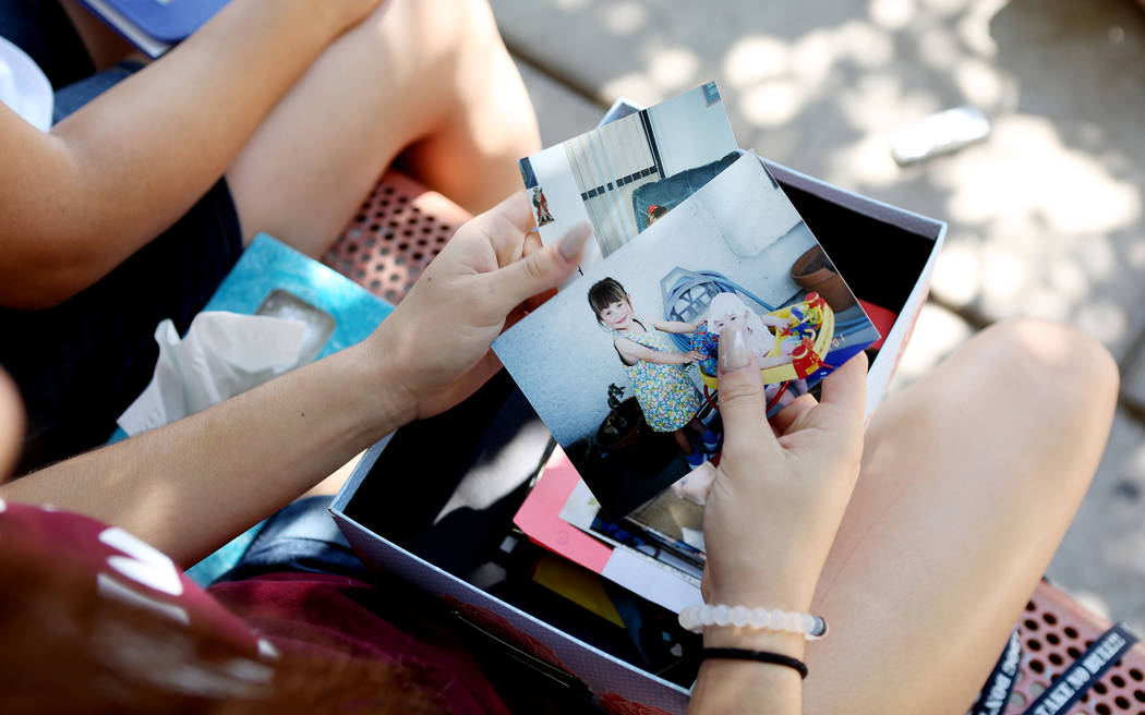 Allison Rogers, cousin of Haylei Hughes, who died in hiking accident July 26 in Washington state, shows photos of Hughes at age three, during an interview at Trails Park in Summerlin, Tuesday, Aug ...