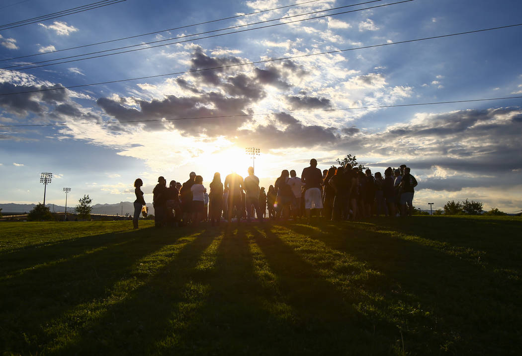 People gather during a vigil for Haylei Hughes, a former Cimarron-Memorial student-athlete, who died in a hiking accident in Wash., at Kellogg Zaher Sports Complex in Las Vegas on Thursday, July 2 ...