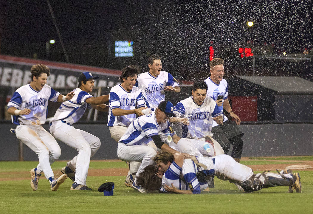 The Southern Nevada Blue Sox celebrate after winning the American Legion Baseball Nevada State Tournament championship game on Saturday, July 29, 2017, at at Earl E. Wilson stadium at UNLV. On Sun ...
