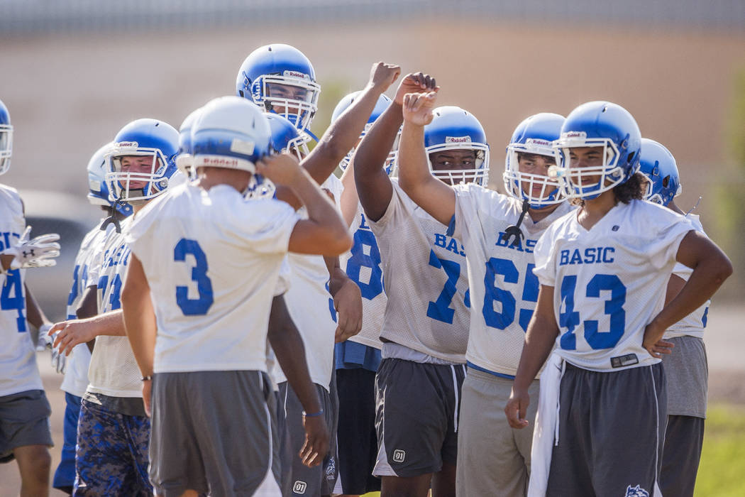 The Basic Wolves come together while taking a break in practice at Basic High School football field on Monday, Aug. 7, 2017.  Patrick Connolly Las Vegas Review-Journal @PConnPie