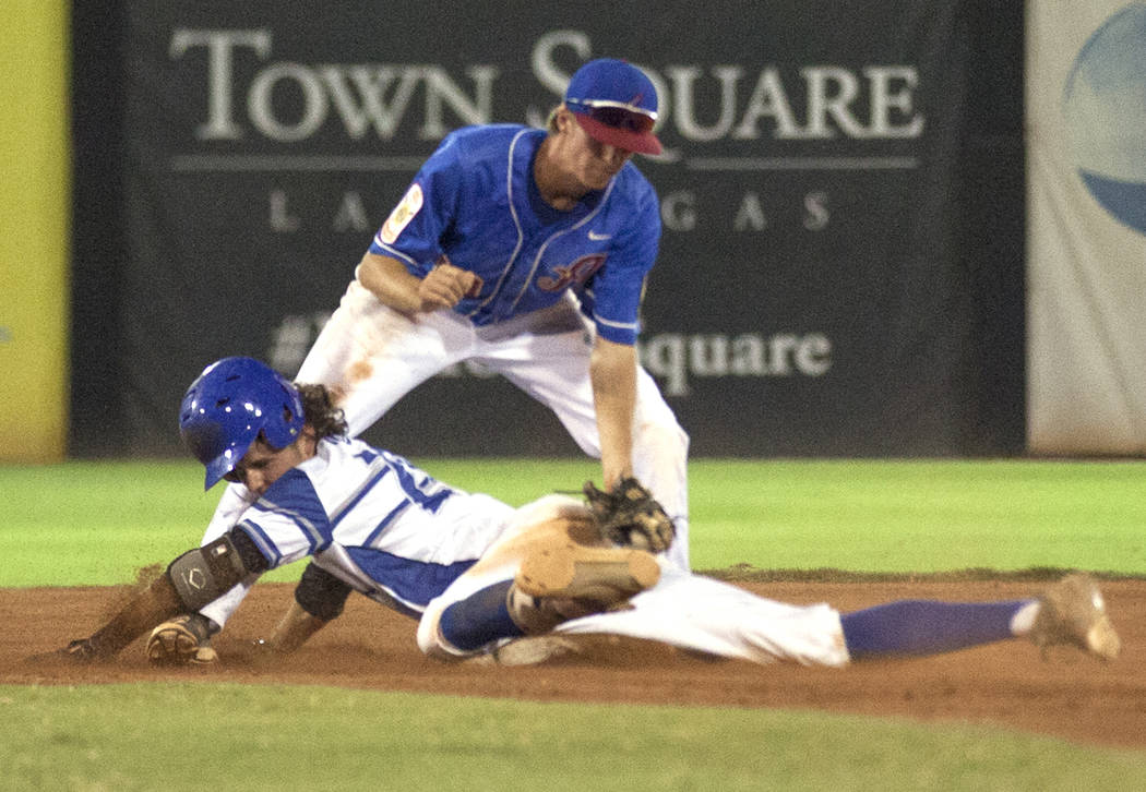 Las Vegas Aces' Cole Schaeffer (10) attempts to tag out Southern Nevada Blue Sox's Ryne Nelson (29) on Saturday, July 29, 2017, at the American Legion Baseball Nevada State Tournament championship ...