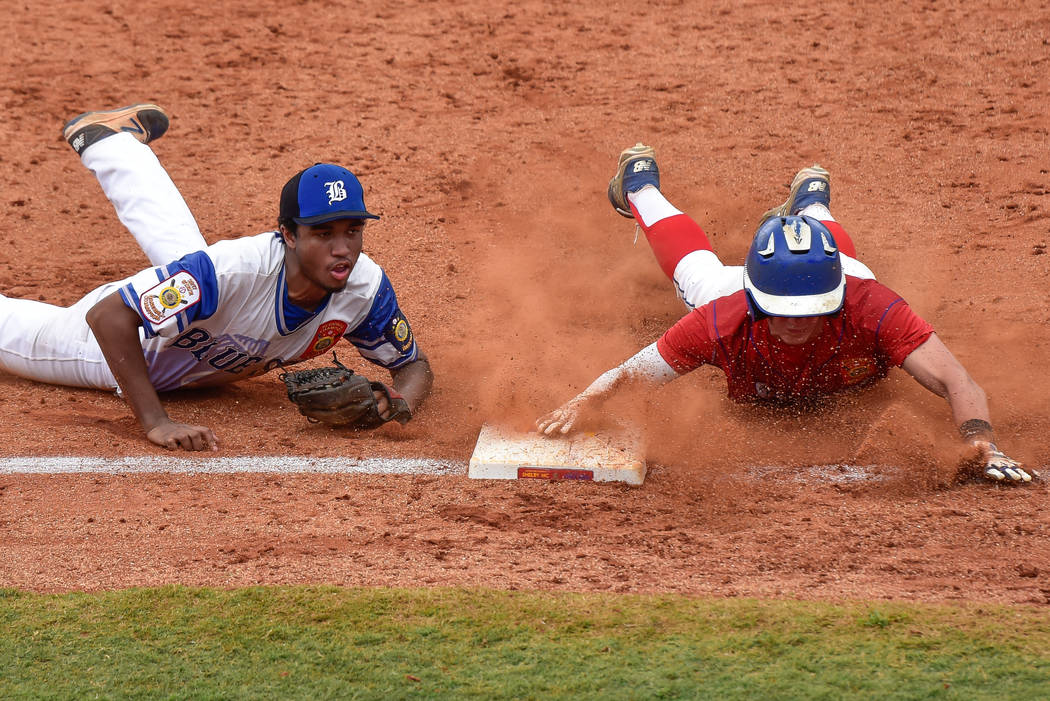 Omaha, Neb., shortstop Zach Luckey slides safely into third in game 2 of The American Legion World Series on Thursday, August 10, 2017 in Shelby, N.C.. Photo by Matt Roth/The American Legion.