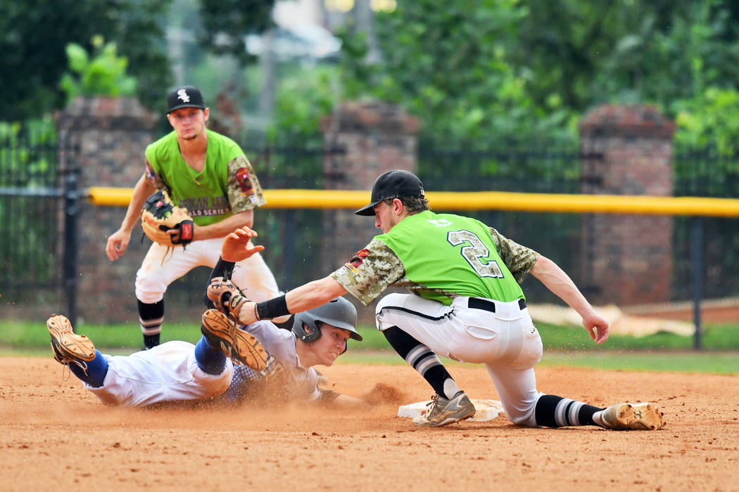 David Hudleson of Henderson, Nev., Post 40 is picked off by Seth Tucker of Bryant, Ark., Post 298 after attempting to steal second base during game 13 of The American Legion World Series on Monday ...