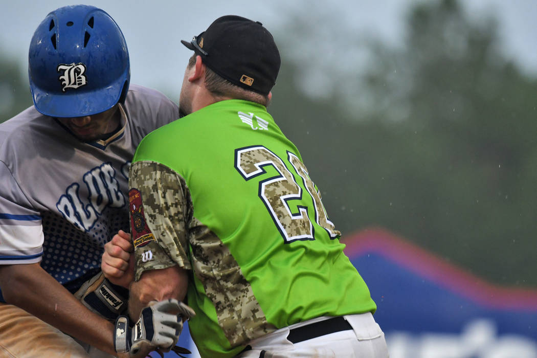 Garrett Giles of Henderson, Nev., Post 40 collides with first baseman Brandon Hoover of Bryant, Ark., Post 298 during game 13 of The American Legion World Series on Monday, August 14, 2017 in Shel ...