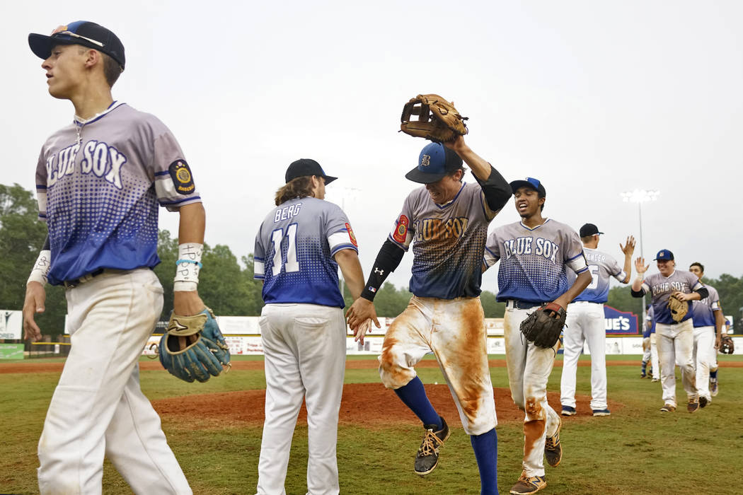 Members of Nev., Post 40 celebrate their 7-3 win over Bryant, Ark., Post 298 during game 13 of The American Legion World Series on Monday, August 14, 2017 in Shelby, N.C.. Photo by Matt Roth/The A ...