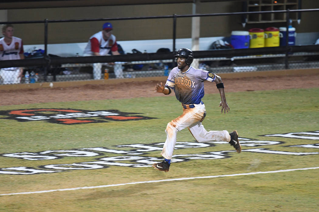 J.J. Smith of Henderson, Nev., Post 40 runs home to score the go-ahead run against Omaha, Neb., Post 1 during the championship game of The American Legion World Series on Tuesday, August 15, 2017  ...