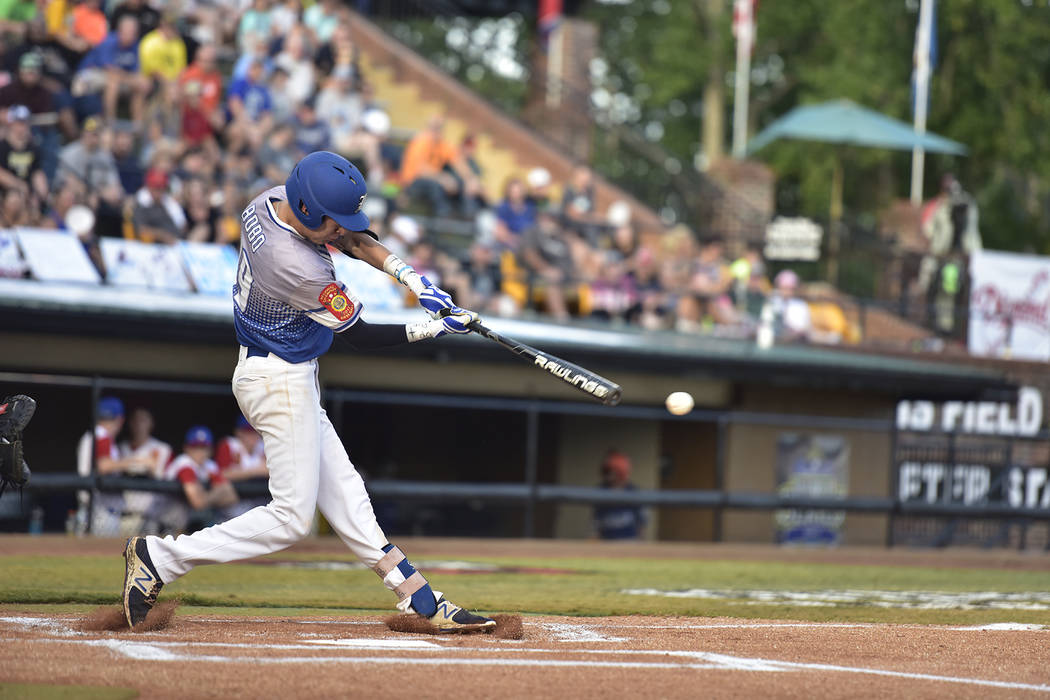 John Howard Bobo of Henderson, Nev., Post 40 starts the game off with a single against Omaha, Neb., Post 1 during the championship game of The American Legion World Series on Tuesday, August 15, 2 ...