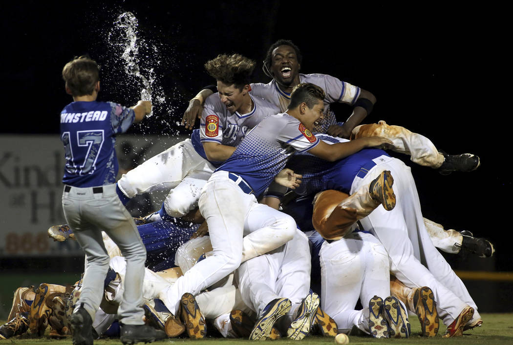 Players from Henderson, Nev., celebrate on after their 2-1 win over Omaha, Neb., for the 2017 American Legion World Series championship title baseball game in Shelby, N.C. on Tuesday, Aug. 15, 201 ...