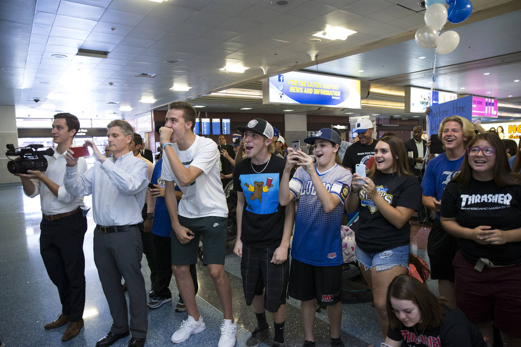 Family and friends wait for the Southern Nevada Blue Sox baseball team at McCarran International Airport in Las Vegas, on Wednesday, Aug. 16, 2017. The Blue Sox won the American Legion World Serie ...