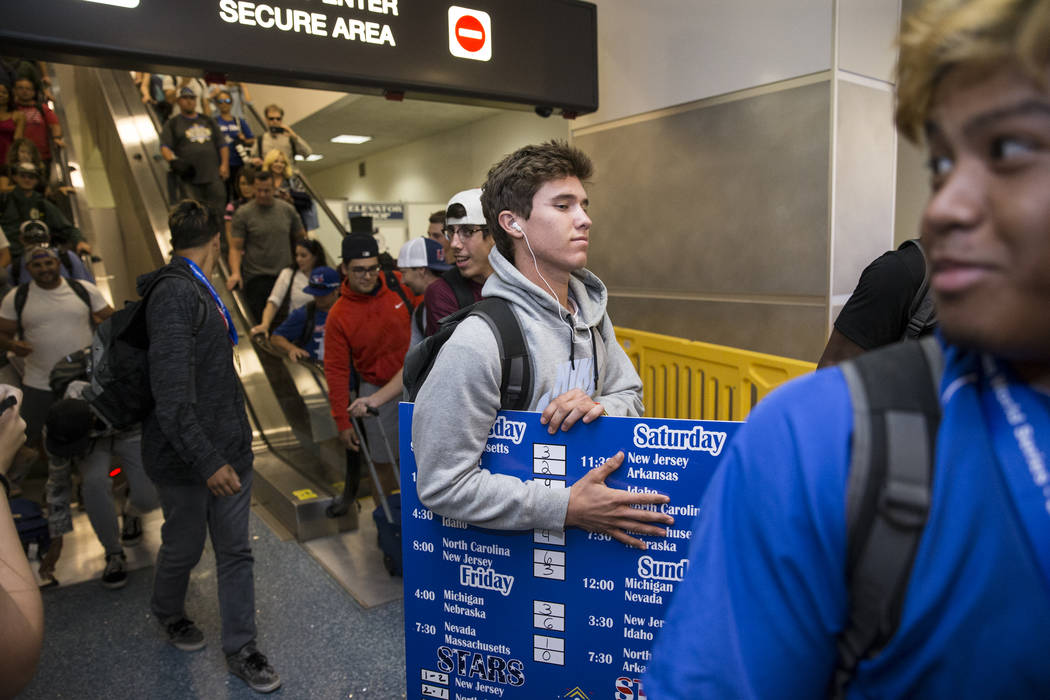 Southern Nevada Blue Sox baseball player David Hudleson, 19, arrives to McCarran International Airport with his team after their victory in the American Legion World Series championship, in Las Ve ...