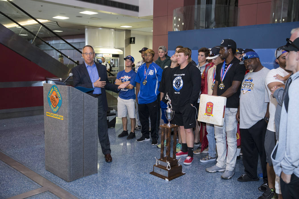 Clark County Commissioner Jim Gibson, left, during a welcome ceremony for the Southern Nevada Blue Sox baseball team after their win in the American Legion World Series championship, at McCarran I ...