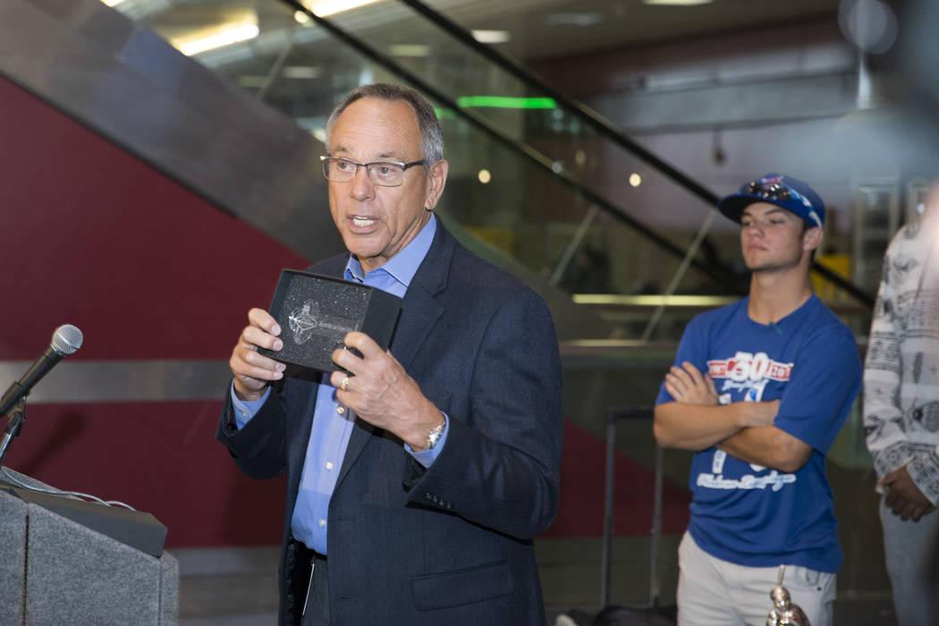 Clark County Commissioner Jim Gibson, left, presents the key to the Las Vegas Strip to the Southern Nevada Blue Sox baseball team after their win in the American Legion World Series championship,  ...
