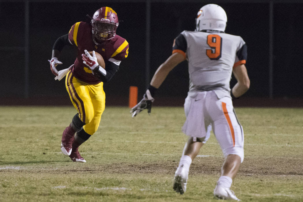 Del Sol's Taariq Flowers (5) runs with the ball against Chaparral's Devin Gaddy (9) during a football game at Del Sol in Las Vegas, Friday, Sept. 23, 2016. Jason Ogulnik/Las Vegas Review-Journal