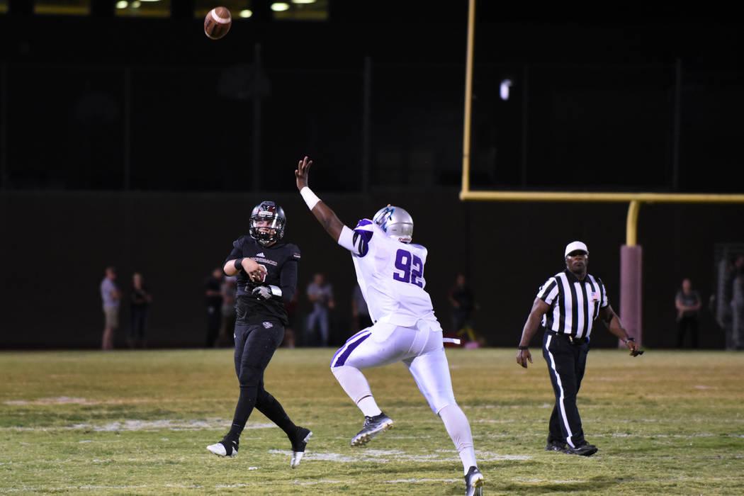 Desert Oasis Mitch Moniz (2) throws the ball against Silverado's Von White (92) during their football game played at Desert Oasis football field in Las Vegas on Friday, Sept. 9, 2016. Martin S. Fu ...