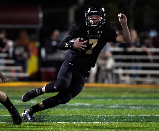 Faith Lutheran quarterback Sagan Gronauer carries the ball against Shadow Ridge during a high school football game at Faith Lutheran High School, Friday, Oct. 21, 2016, in Las Vegas. David Becker/ ...
