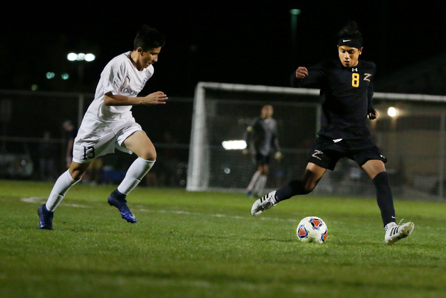 Durango's Erick Martinez Rodriguez (8) kicks the ball against Coronado at the Bettye Wilson Soccer complex during the neutral playoff game Friday, Nov. 11, 2016, in Las Vegas. Coronado defeated Du ...