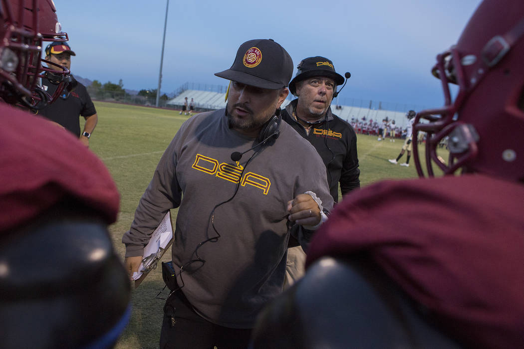 Del Sol head coach Mike Valenzuela speaks with players during a three-team scrimmage at Del Sol High School on Friday, Aug. 18, 2017, in Las Vegas. This is Valenzuela's first year coaching Del Sol ...