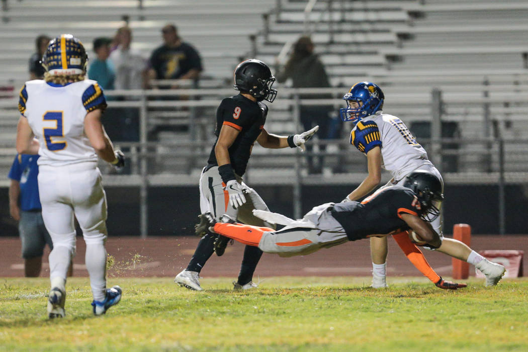 Chaparral  junior Tyray Collins (19) dives across the goal line for a touch down during a football game against Moapa Valley, held at Chaparral High School in Las Vegas, Friday, Oct. 21, 2016. Don ...