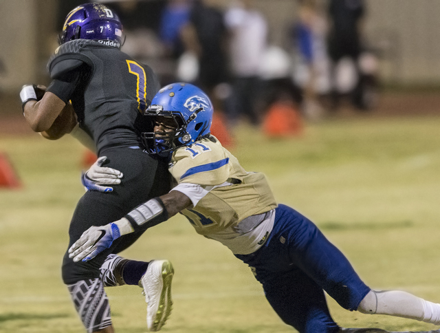 Sierra Vista defender Damaen Bentley (11) tackles Durango's T.K. Fotu on Friday, Oct. 21, 2016, at Durango High School, in Las Vegas. Benjamin Hager/Las Vegas Review-Journal