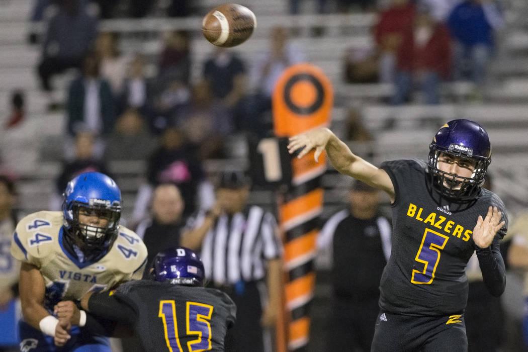 Durango quarterback Kaden Renshaw (5) makes a throw on Friday, Oct. 21, 2016, at Durango High School, in Las Vegas. Benjamin Hager/Las Vegas Review-Journal