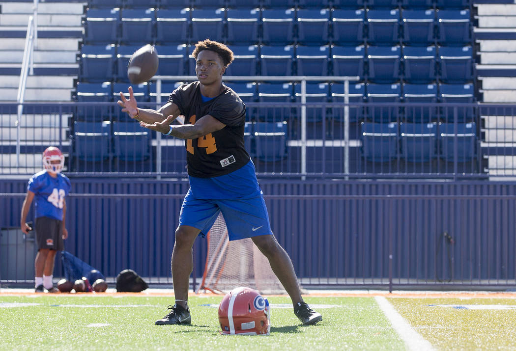 Bishop Gorman quarterback Dorian Thompson Robinson receives a pass during practice at Fertitta Field at Bishop Gorman High School Monday, Aug. 21, 2017, in Las Vegas. Bridget Bennett Las Vegas Rev ...