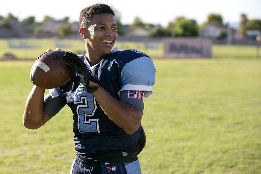 Canyon Springs football player Diamante Burton prepares to pass a ball between drills during practice at Canyon Springs High School on Tuesday, Aug. 22, 2017, in North Las Vegas. Bridget Bennett L ...