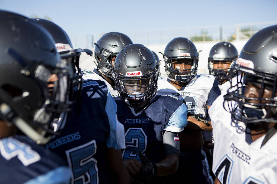 Canyon Springs football player Diamante Burton (2), center, huddles with teammates during practice at Canyon Springs High School on Tuesday, Aug. 22, 2017, in North Las Vegas. Bridget Bennett Las  ...