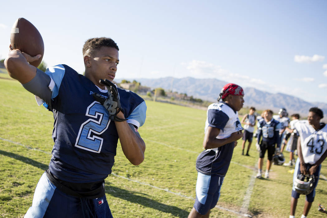 Canyon Springs football player Diamante Burton pass a ball between drills during practice at Canyon Springs High School on Tuesday, Aug. 22, 2017, in North Las Vegas. Bridget Bennett Las Vegas Rev ...