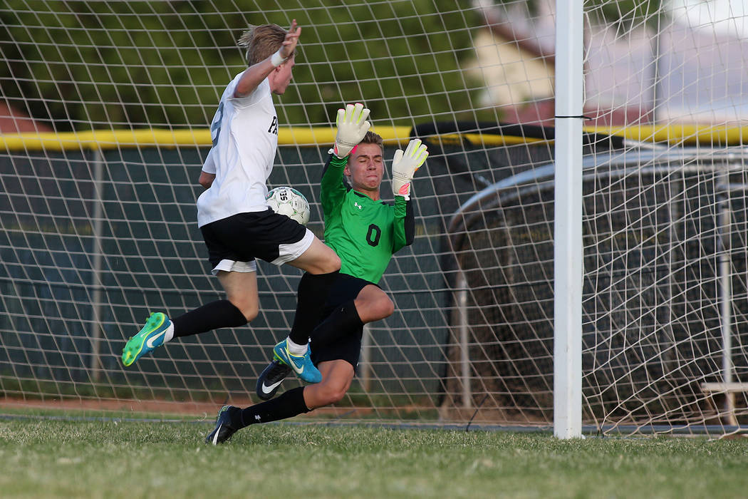 Faith Lutheran goalie Landon Amick attempts to save the ball as Palo Verde player Presten Manthey makes the first goal of the game at Green Valley High School on Monday, Aug. 28, 2017, in Las Vega ...