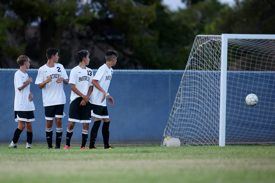 Palo Verde players watch as a Faith Lutheran player kicks a free kick at their goal during a game at Green Valley High School on Monday, Aug. 28, 2017, in Las Vegas. Palo Verde won 2-0. Bridget Be ...